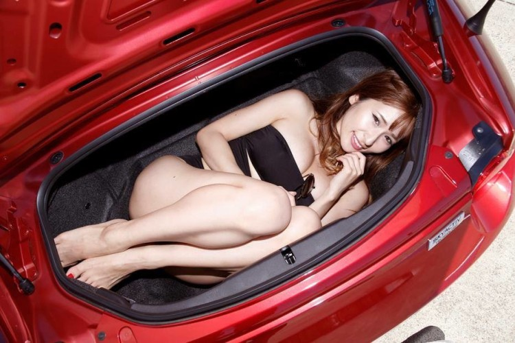 girl in miata trunk